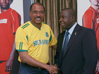 Michel Sidibe shaking hand with Kirsten Namatandani